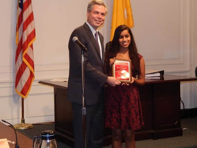 Mayor Thomas Roach presents Raina Kadavil with the White Plains Youth of the Year 2014 award.