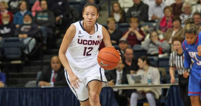 Ossining's Saniya Chong scored a career-high 20 points Monday night but UConn lost in overtime to Stanford, 88-86.