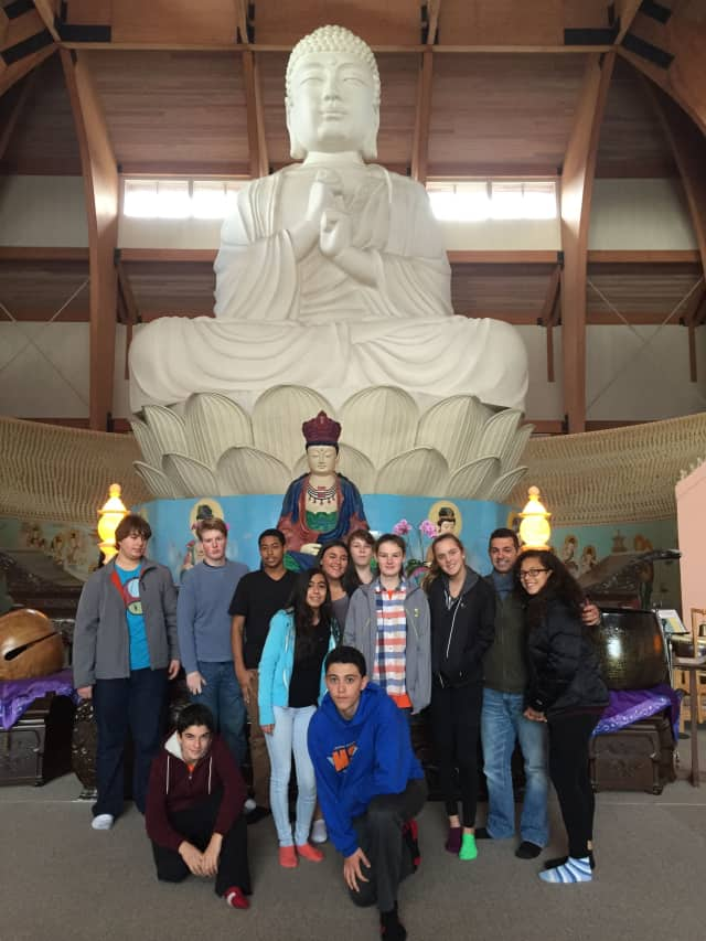 Briarcliff High School students pose with the largest Buddha statue in the Western Hemisphere at Chuang Yen Buddhist Monastery in Kent.