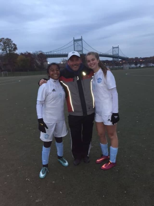 Isabelle Tola (left) and Bridget Richer (right) celebrating their victory in Randalls Island, 6-0, which locked the team in the second round in the N.Y. Cup Tournament.