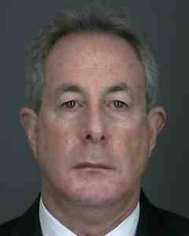Alan Offenberg was charged with two felony counts after allegedly submitting false assessment reports.