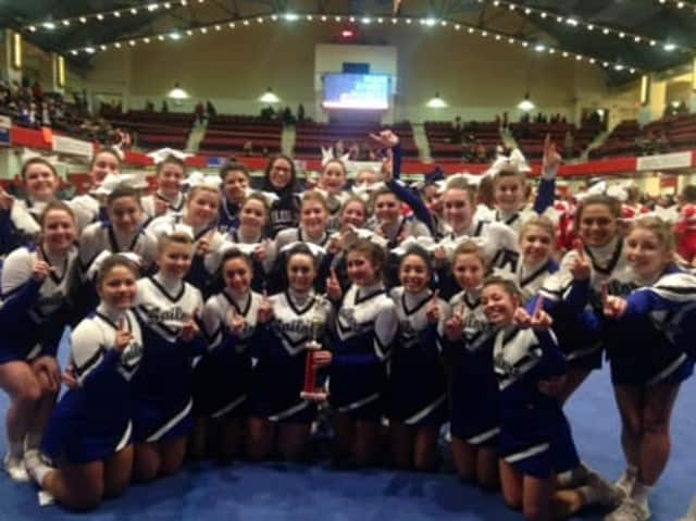 Hen Hud cheerleaders pictured with their first-place trophy.
