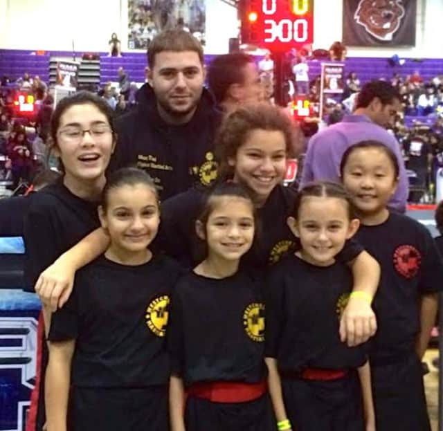 Pictured at the NAGA Championships with their instructor Ron Barone, from left: Emma Keegan, Maria Cristo, Amanda Monteleone, Isabel Macera, Alexa Grassi and Audrey Horn.
