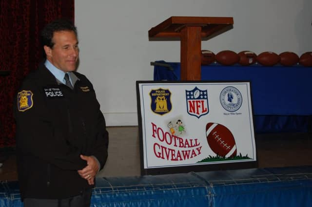 Comnissioner Charles Gardner distributed footballs provided by the NFL to St. Peter's Church.