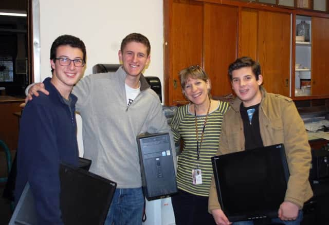 Alec, Aaron and Mitch Feldman, with Barbara Peist, who teaches English at Nellie A. Thornton H.S., in Mount Vernon.