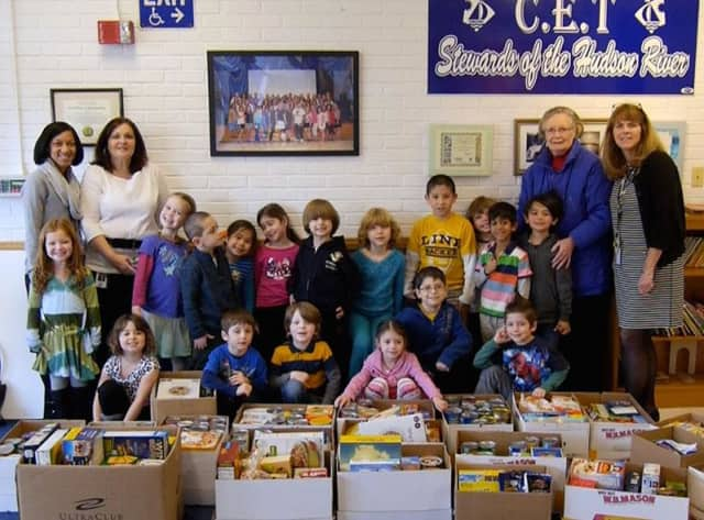 Carrie E. Tompkins Elementary School social worker Renee Tanner, second from left, students and faculty with the food donations collected through a partnership with the Croton Caring Committee.