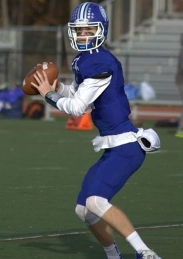 Darien quarterback Tim Graham led the Blue Wave to the FCIAC title, defeating archrival New Canaan in a game Thursday at Boyle Stadium in Stamford.