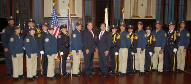 Sgt. Gabriel Barahona is pictured at extreme left, and Detective William Celestino is at extreme right.
