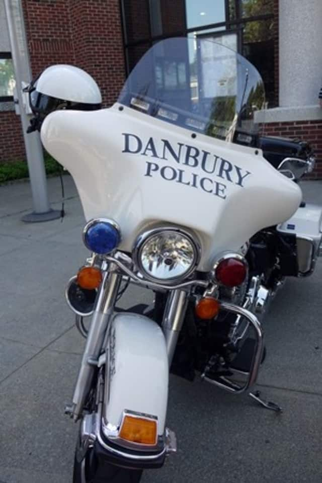 """A Danbury grandmother said she was """"scared to death"""" after two masked men broke into her home."""