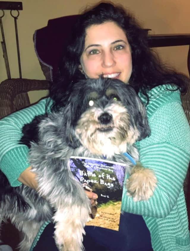 Laura Scott Schaefer with her dog, Crumbles.