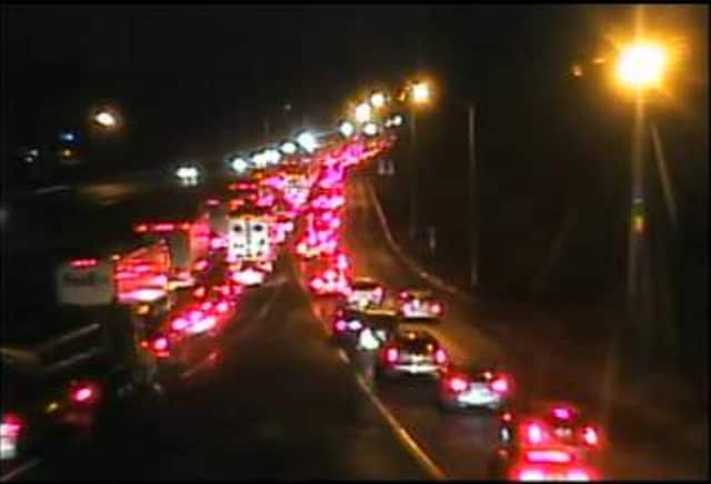 Traffic is jammed at about 8:25 p.m. on I-84 west near Exit 6 in Danbury after a truck struck and killed a woman.