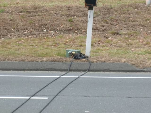 A traffic counter similar to this one on Danbury Road in Wilton on Tuesday was reported stolen last week from the Westport Road and Poplar Plain Road in Wilton. The traffic box counter is worth about $600.
