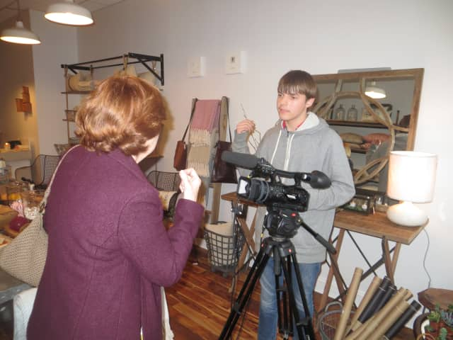 Larchmont Mayor Anne McAndrews talks to a local camera crew during the recent grand opening of Village Mercantile.