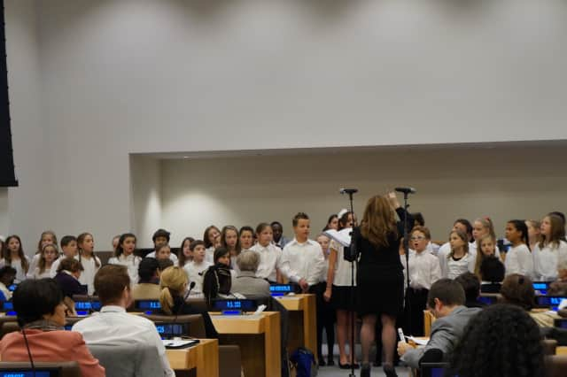 Carrie E. Tompkins Elementary School fourth-graders sang during the United Nations' 25th anniversary celebration for the Convention on the Rights of the Child.