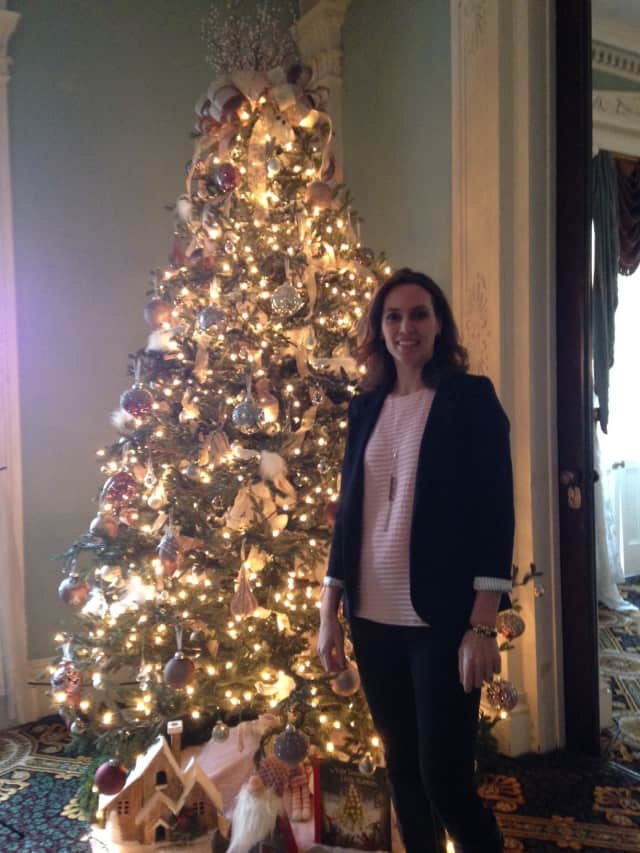 Pelham resident Alice Pirsu with the tree she decorated for the Bartow-Pell Mansion Museum.