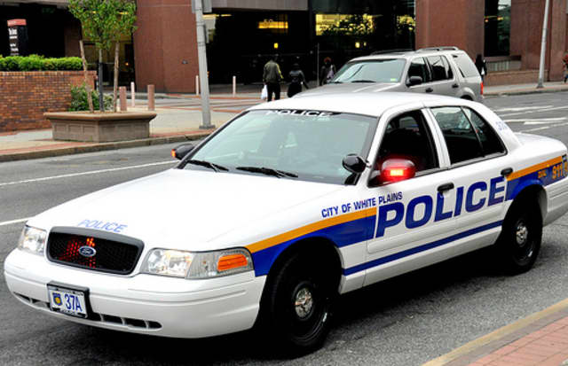 A White Plains police officer was suspended without pay after he allegedly beat his girlfriend, who is also a cop.