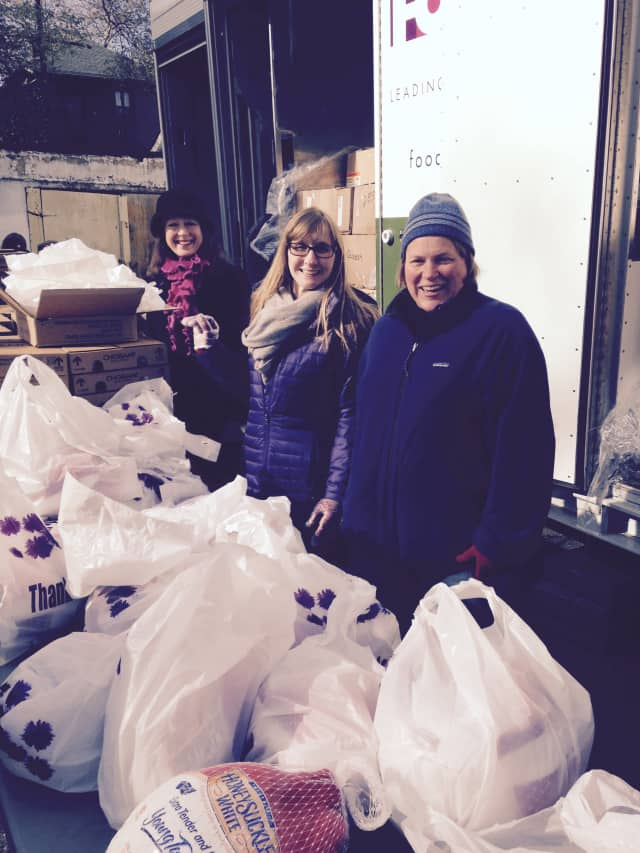 Junior League of Bronxville members Julie Latham, Elizabeth Peacock and Kathryn Hentschel help distribute turkeys to those in need at Beulah Church in Mount Vernon.