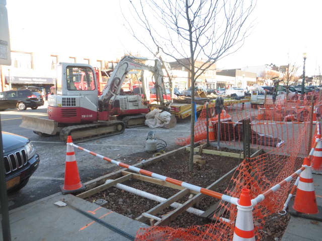 Recent sidewalk work along Mamaroneck Avenue. Extensive paving is planned Monday through Friday on a dozen Village of Mamaroneck streets.