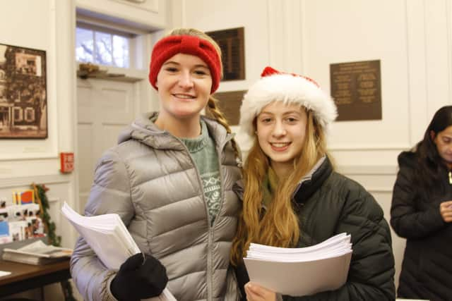 Girl Scouts Hannon Eberts, left, and Cassie Panzarino of Somers hand out programs at the Elephant Hotel.