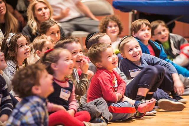 Children enjoy the entertainment at JCC Greenwich's annual Hanukkah Party this past Sunday.