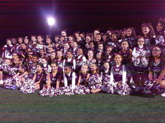 The Ossining Little League cheerleaders.