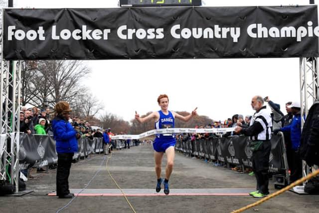 Darien's Alex Ostberg crosses the finish line last month when he won the Foot Locker Northeast Regional championship in New York.