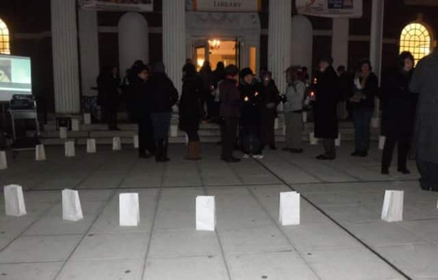 About 60 people attended a recent Stamford Vigil of Hope event in front of the Ferguson Library.