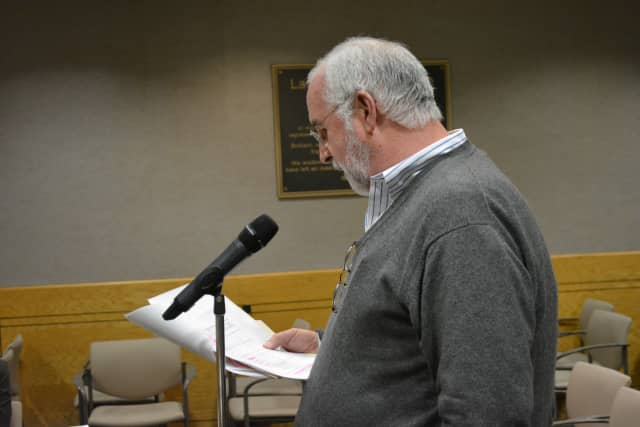 Resident William Devaney speaks at the New Castle Town Board's Chappaqua Crossing meeting.
