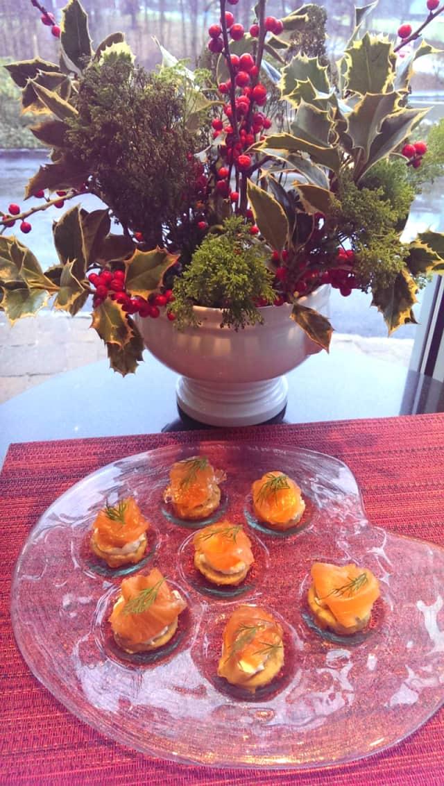Potato latkes with salmon gravlox and horseradish sour cream.