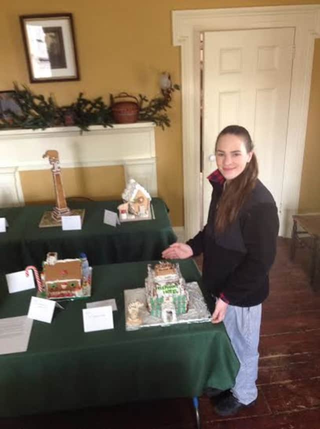 Pastry Chef Patrice Lovell with The Elephant Hotel gingerbread house, recipient of the Pastry Chef award in the Somers Historical  Society Gingerbread festival.