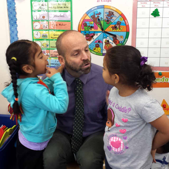 Leake & Watts Executive Director Alan Mucatel talks with children at the Leake & Watts Ames Early Childhood Learning Center in Yonkers.