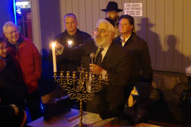 Circle of Friends, a volunteer group that serves people with special needs, is holding a Hanukkah festival Tuesday, Dec. 8, at Beth Israel of Westport/Norwalk. Rabbi Yehoshua Hecht of Beth Israel  lights candles on the menorah.