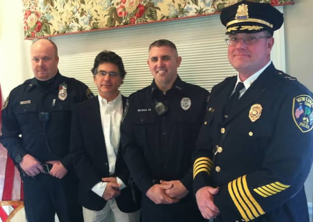 Charlie Taben, second from left, at a ceremony honoring Officers Michael O'Sullivan, left, and Brian Micena, second from right, for helping to save his life after he had cardiac arrest on Oct. 18. At right is Chief Leon Krolikowski.