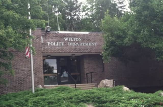 Wilton Police charged a man who allegedly grabbed and pushed his girlfriend during a dispute as they decorated a Christmas tree on Saturday.