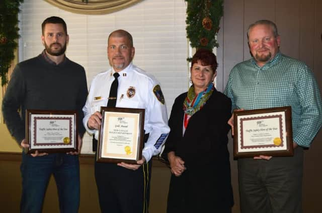 Fran Mayko, AAA public affairs manager , second, right, presented Capt. Vince DeMaio, second, left, with a Gold Award, and Officer Tom Patten, left, and Officer Geoff Lambbert, right, with Traffic Safety Hero Awards.