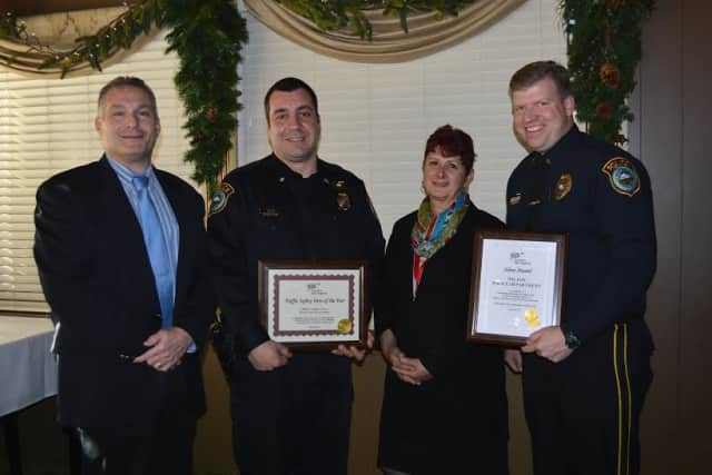 At AAA's 5th Annual Community Traffic Safety Awards lunch recently at Marisa's, Trumbull, public affairs manager Fran Mayko, second, right, presented the awards to, from left, Chief Michael Lombardo, Officer Anthony Cocco and Lt. Thomas Conlon.