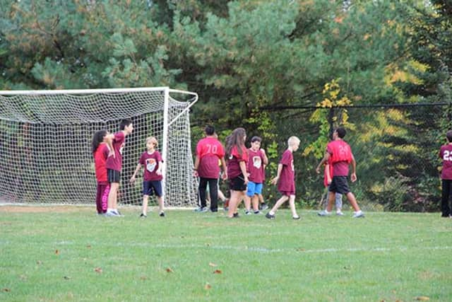 Members of the Danbury Youth Soccer club will be able to keep playing at a field purchased by Danbury Billionaire Peter Buck until they find a replacement.