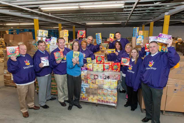 Representatives from Nabisco and the Stop & Shop Supermarket Co. donate pallets of Nabisco food items to the Food Bank of the Hudson Valley.