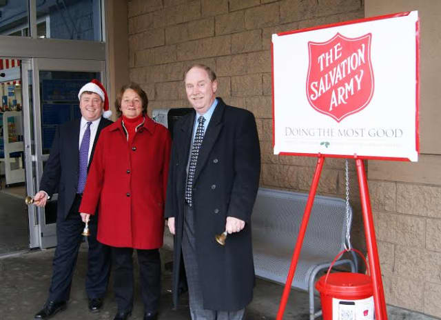 From left, Reps. Dan Carter and Jan Giegler and Sen. Michael McLachlan volunteer in 2014 as bell ringers for the Salvation Army outside the Wal-Mart in Danbury.