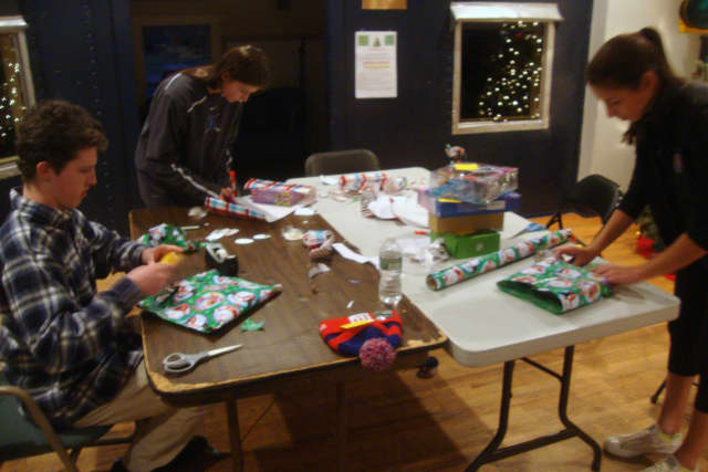 Nick Murphy, Kerry Blatney and Laura Schwartzman wrap gifts during the Depot's 2014 Wrap Up event.