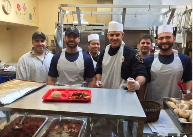 New Canaan police offices help prepare and serve lunch at Norwalk's Open Door Homeless Shelter.