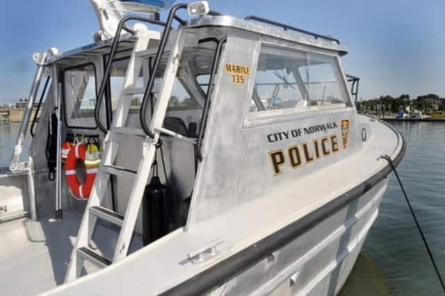 The Norwalk Police Department's Marine Division assisted in helping two Westport men whose boat capsized.