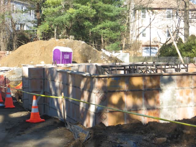 A hole surrounding a new foundation was cordoned off with cones and caution tape Saturday where a car fell in Friday night.