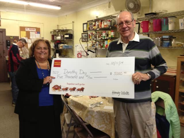 The Dorothy Day Hospitality House and its donation check.