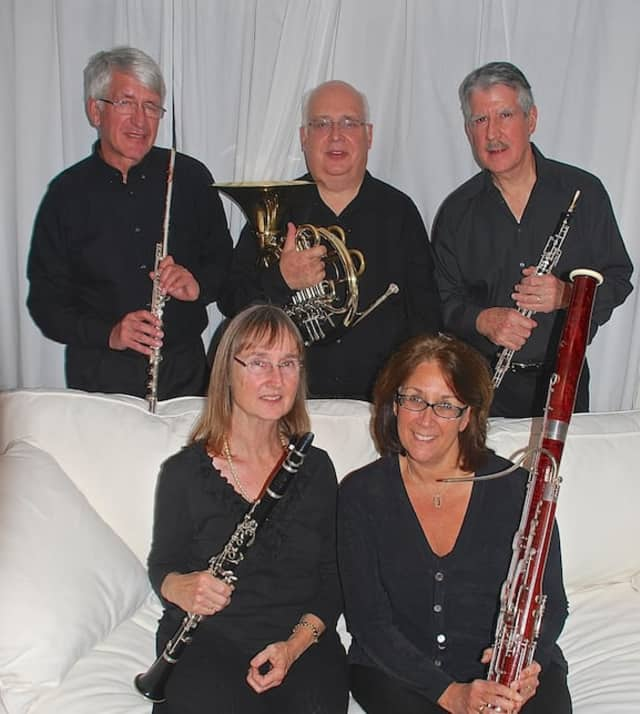 The Madera Winds quintet is comprised of (l-r, back row): Jan van den Berg (flute), John Harley (horn), Ralph Kirmser (oboe); (l-r, seated): Janet Atherton (clarinet) and Rosemary Dellinger (bassoon).