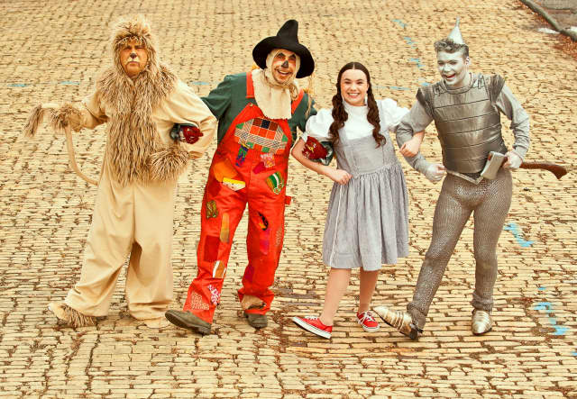"""The cast of an upcoming Peekskill production of """"The Wizard of Oz,"""" at the famed yellow brick road."""