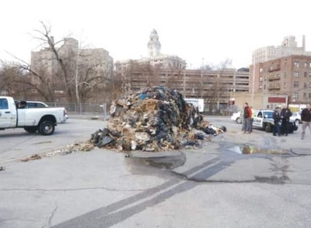 Yonkers police officers charged a man with illegal dumping in a local parking lot.