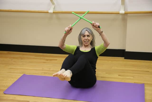 Peggy Raiskums shows off a squat in her new POUND Fitness class.