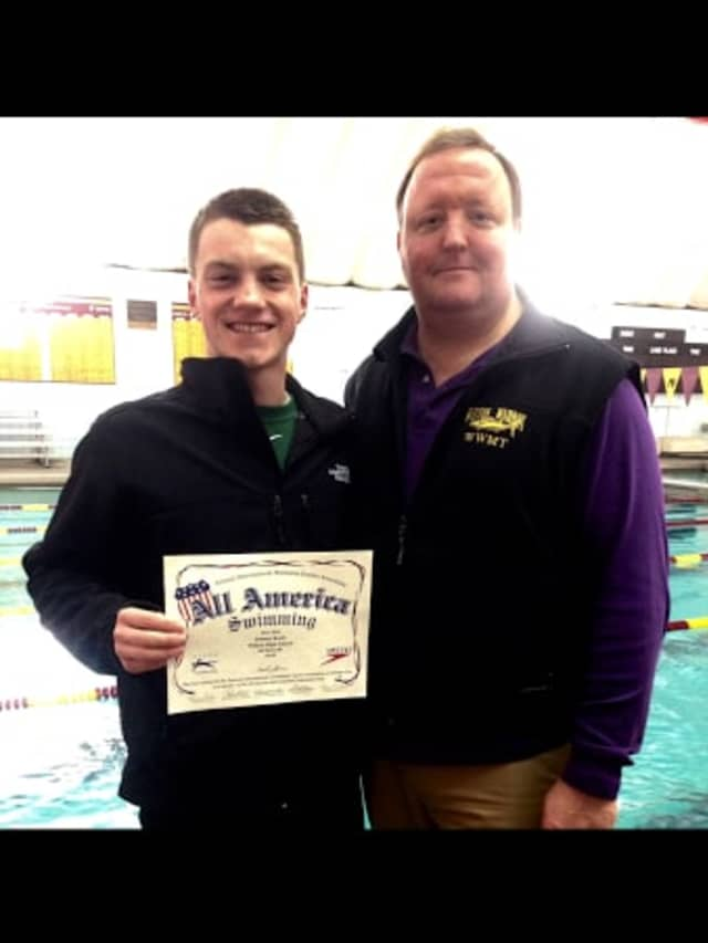 Tommy Kealy and WHS swim coach Todd Stevens with Kealy's interscholastic All-American certificate.