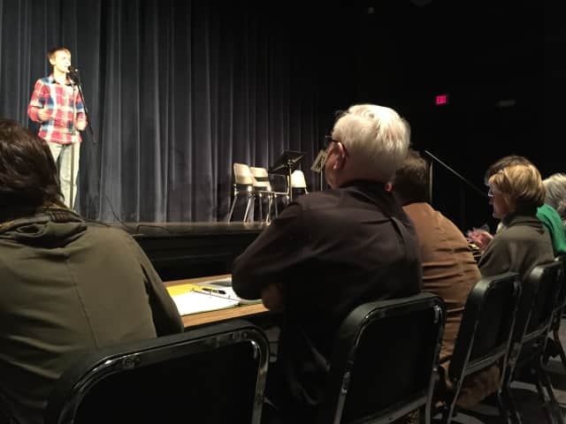 Judges carefully listed to John Jay High School's 25 finalists recite poems as part of the Poetry Out Loud: National Recitation Contest.